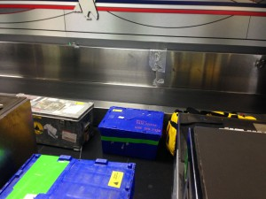 Research equipment and plenty of warm clothes await shipment at the Logan Airport baggage counter.