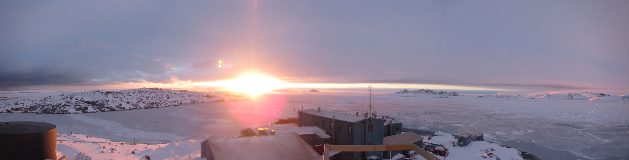 Sunset over the waters of the Bismarck Strait on Oct. 27. While each spring day brings more daylight to the Peninsula, the sea around the station remains icebound.