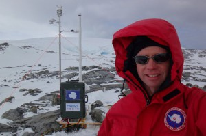 "Greg Roberts poses in Palmer's ""backyard"" with PAEROS, the Portable Aerosol Observing System. Roberts and Craig Corrigan, atmospheric scientists from  the Scripps Institution of Oceanography, developed the autonomous instrument package to measure aerosol particles in the surface atmosphere."