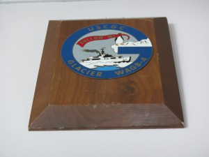 A ship's plaque bearing the coat of arms of the Coast Guard Cutter Glacier commemorates one of many visits by the icebreaker to Palmer Station during the 1970s and 1980s.