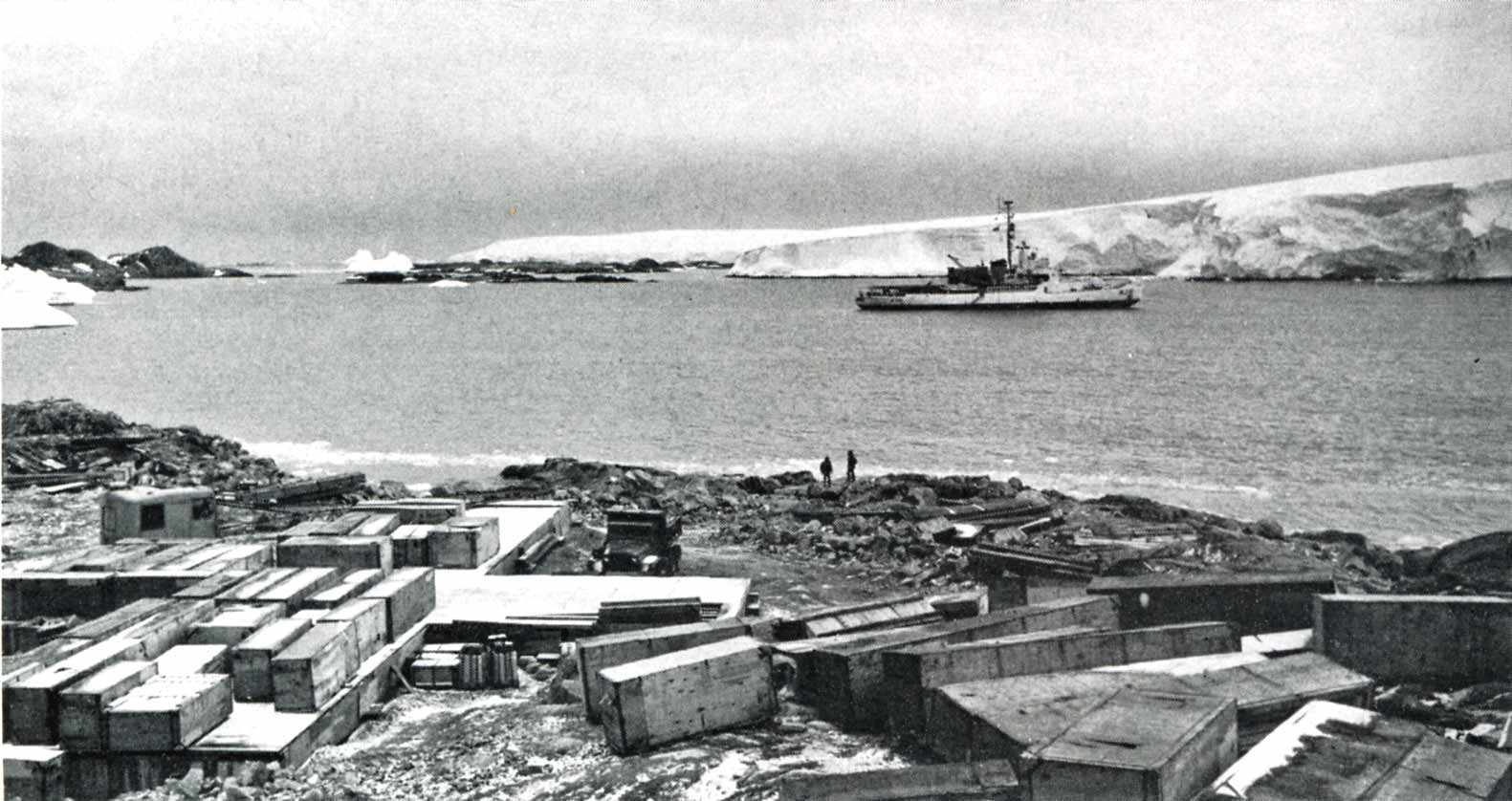 The Coast Guard Cutter Westwind at anchor in Arthur Harbor in winter 1967, after arriving on January 8 with a team of Navy Seabees. After transferring the team and several tons of gear ashore, the Westwind stayed on station as construction began on Palmer Station. Photo from the Palmer Station history pages at palmerstation.com.