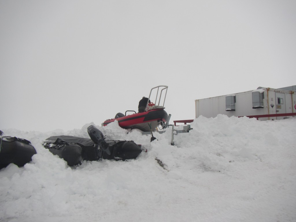 Anomalously high precipitation this winter means mountains of snow covering everything here on station... including the small boats! Jack (one of the marine technicians) is busy digging.