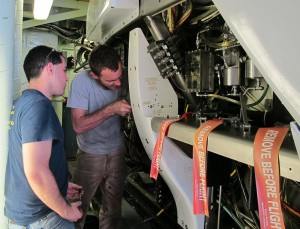 Alvin techs Logan Driscoll (left) and Jefferson Grau work on the sub's variable ballast system.