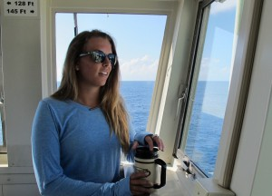 Second mate Max Kantor keeps an eye on deck operations during her morning watch.