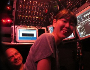 Sayaka Mino in the pilot seat of Alvin (with Stefan Sievert peeking from behind)