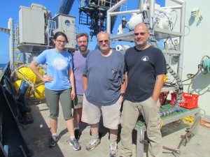 The Vent-SID group (Nuria Fernandez Gonzalez, Jeremy Rich, Craig Taylor, and Stefan Sievert) in front of the instrument they tested at sea for the first time