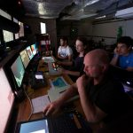 Mario Fernandez, Casey Machado, Tim Shank, and Santiago Herrera (left to right) in the Nereus control room during an 8-hour dive to 6,000 meters. (Photo by Ken Kostel, Woods Hole Oceanographic Institution)