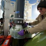 Scripps Institution of Oceanography microbiologist Doug Bartlett collects a water sample from the hadal elevator to study the microbial diversity of the deep ocean. (Photo by Ken Kostel, Woods Hole Oceanographic Institution)