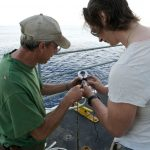 R/V Thomas G. Thompson able-bodied seaman Brian Clampitt (left) instructs University of Aberdeen biologist Tom Linley in the art of splicing an eye into a line. (Photo by Ken Kostel, Woods Hole Oceanographic Institution)