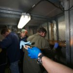Close quarters in the ship's cold room. (Photo by Ken Kostel, Woods Hole Oceanographic Institution)