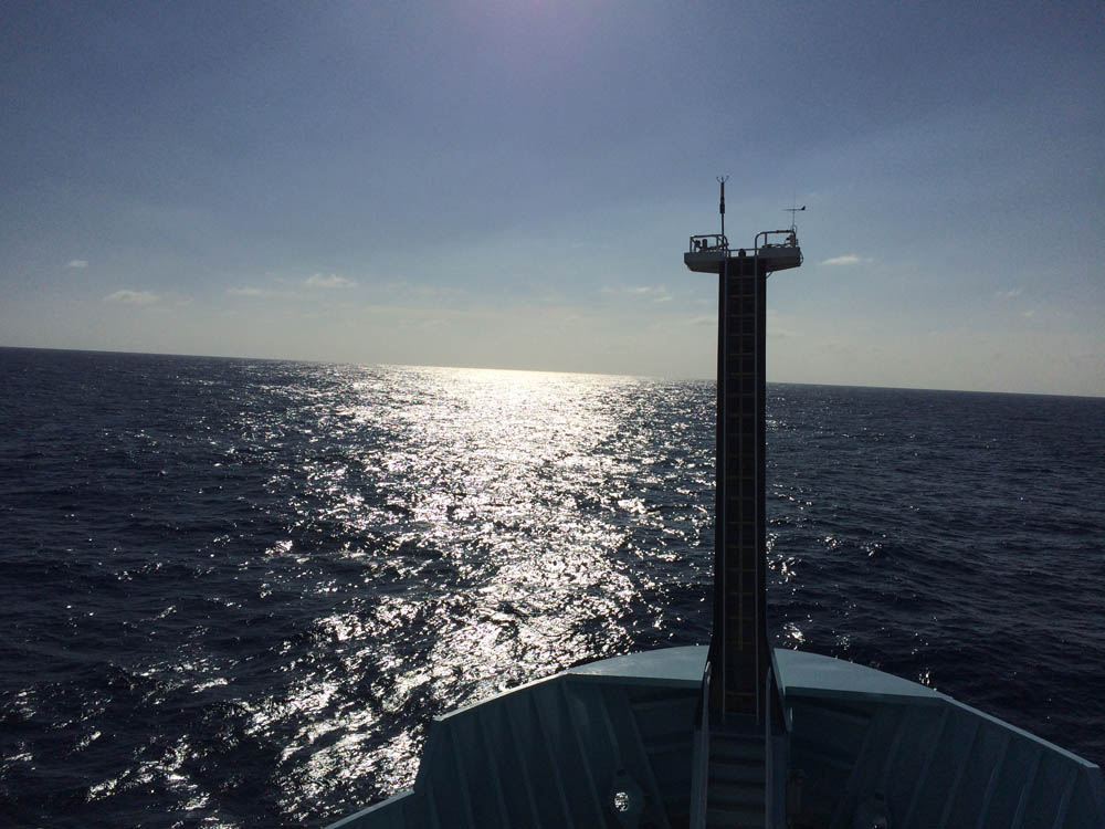 A view from one of the upper decks over the foremast at the front of the ship; it's rare to see the foremast perpendicular to the horizon like this (J. Greene)