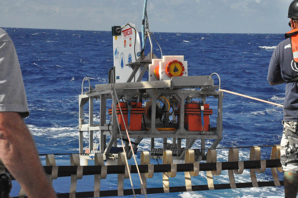 The DeepTow sled, carrying two magnetometers, is deployed overboard off the a-frame