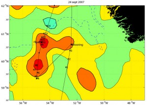 This figure shows the probable locations of several Irminger Rings in color shading. The data are from a satellite that measures sea surface height. Just like high and low pressure systems in the atmosphere, eddies have high and low pressure at their centers. The Irminger Rings are noted by high pressure, or high sea surface height, indicated here by red colors. These measurements of eddy locations are only approximate. We had to verify the locations of eddies using temperature profilers called Expendable Bathythermographs, or XBTs. As we approached the mooring site from the southwest, we released several XBTs to find out if the weak high pressure at that site was an eddy. Turned out it wasn't. After putting the mooring in, we steamed down to the southwest where there were two more high pressure systems. We started releasing XBTs along a path cutting through both possible eddies. You can see that the *'s, which mark the locations of the XBT profiles, are not right on the planned cruise track (the thin black line). This is because the wind was blowing so hard, and the waves were so big, that the ship could not follow the planned track exactly. The temperature profiles in the first of the two eddies were inconclusive. So we went on to the second one. Here the temperature probes showed an eddy was present at the same location as the high pressure. So we released one of our floats at the place where we think the eddy center was located. Within hours, the float had started its programmed mission, profiling up and down in the eddy. We hope the float will stay with this eddy and tell us where the eddy goes and how its core properties change with time. (Map by Amy Bower, Woods Hole Oceanographic Institution)