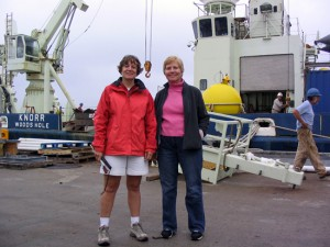 Amy Bower and Kate Fraser stand in front of R/V Knorr before departing on the cruise. (Photo by Terry McKee, Woods Hole Oceanographic Institution)