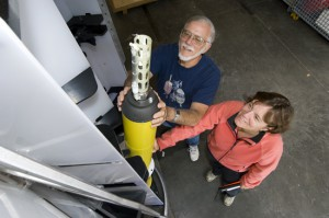 Amy Bower and Jim Valdes check out a Profiling Float. (Photo by Tom Kleindinst, Woods Hole Oceanographic Institution)