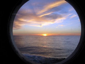Sunset through a port hole. (Woods Hole Oceanographic Institution)