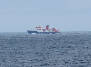 Photo of a ship at sea, the German vessel R/V MSMerian. The ship was about 2 miles away. It is 330 feet long.