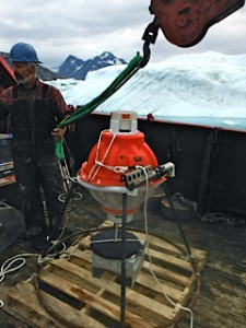 """A PIES deployment in Sermilik in August 2013 with an on-the-fly modification: a pallet strapped to the bottom of the anchor stand to prevent the instrument from sinking into the oozy bottom.   At sea we're usually prepared to """"McGyver"""" things together (albeit in this case without duct tape)."""