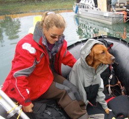 Whit and Britt in the boat with a loadful of instruments and frames.