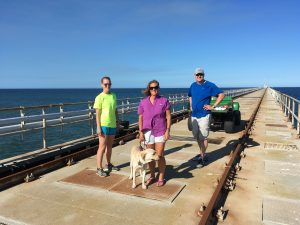 Hugger and me enjoying the cool breeze on the FRF pier, with JP student Suzi Clark (left) and Res. Assoc. III Paul Henderson (right). Its 95F, but the ocean, which is only 63F is wonderful.
