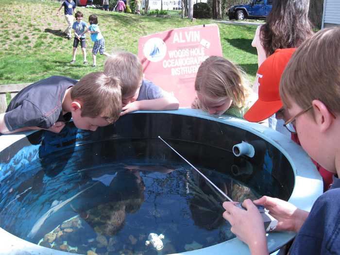 Children pilot a remote controlled submarine