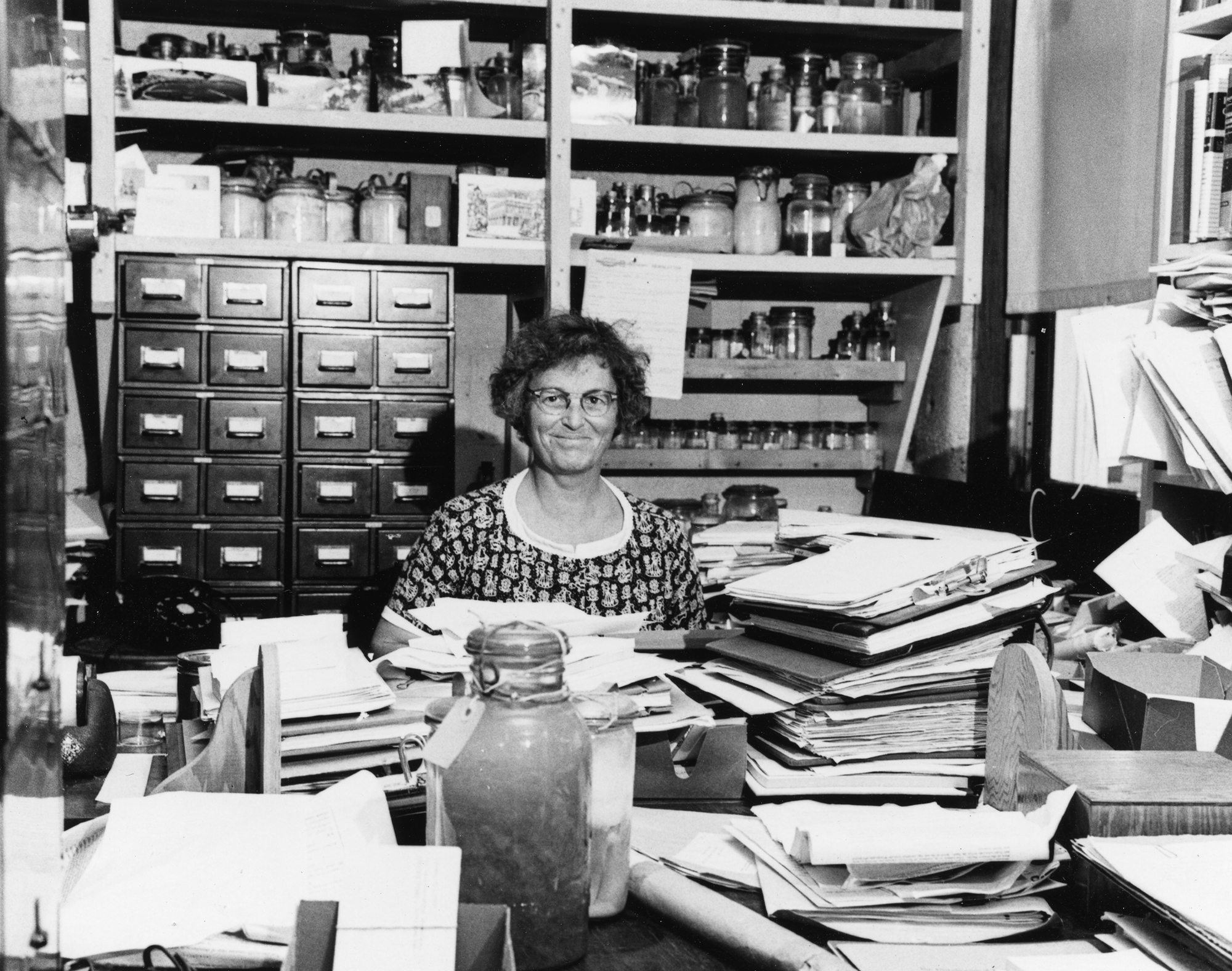 In this 1960 photo, Mary Sears is surrounded by papers and biological samples in her Bigelow Laboratory office.