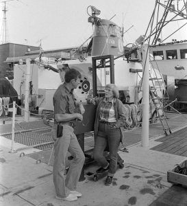 Ruth Turner discusses logistics on R/V Lulu before diving in the sub with then-Chief Alvin Pilot Ralph Hollis, Friday, August 13th, 1971. (Photo by Anne Rabushka, © Woods Hole Oceanographic Institution).